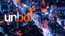 Logo Unbox in letters. Background is a picture of city night light from above.